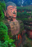 Leshan Giant Buddha. It is carved out of a cliff face that lies at the confluence of the Minjiang, Dadu and Qingyi rivers in the southern part of Sichuan Stock Image