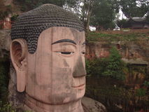 Leshan Giant Buddha. Head of China's Leshan Giant Buddha, the largest stone sculpture of Buddha in the world Stock Photo