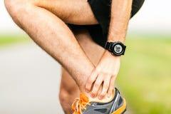 Lesión del dolor de la rodilla de los corredores Fotos de archivo