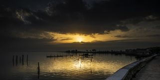 Lesina and its lake. Lesina is a small village that rises on the lake of the same name. The village is located in the province of Foggia, Apulia royalty free stock photo