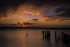 Lake Lesina and its sunset. Lesina is a small village that rises on the lake of the same name. The village is located in the province of Foggia, Apulia royalty free stock photo