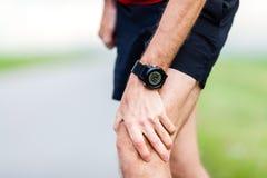 Lesione corrente, dolore del ginocchio Fotografie Stock Libere da Diritti