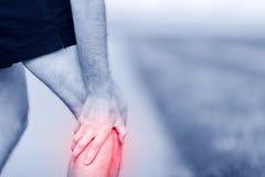 Lesione corrente, dolore del ginocchio Fotografia Stock