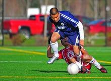 Lesioni di calcio del randello del Mens Fotografia Stock