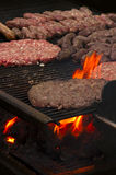 Leskovacki rostilj. Burgers and Mini sausages in southern Serbia style on the grill Stock Photo