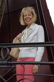 Leslie Plimpton smiles from top of steps at Eiffel Tower, Paris, France - shot August 2015 Stock Images