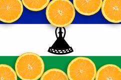 Lesothisk flagga i citrusfruktskivahorisontalram arkivfoton