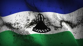 Lesotho grunge dirty flag waving on wind. Lesotho background fullscreen grease flag blowing on wind. Realistic filth fabric texture on windy day Royalty Free Stock Image