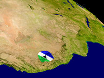 Lesotho with flag on Earth Stock Photo