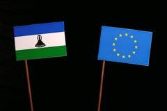 Lesotho flag with European Union EU flag  on black Stock Photo