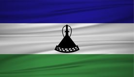 Lesotho flag vector. Vector flag of Lesotho blowig in the wind. Lesotho flag background with cloth texture. EPS 10 Stock Image
