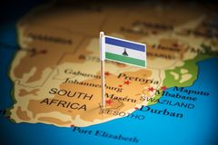 Lesotho marked with a flag on the map.  royalty free stock image