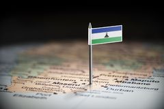 Lesotho marked with a flag on the map.  royalty free stock photo