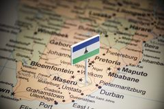 Lesotho marked with a flag on the map.  royalty free stock images