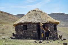Besotho shepherds in front of their hut. Lesotho is one of the poorest countries in the world. Most of the people life in simple huts as shown on the picture Royalty Free Stock Photos