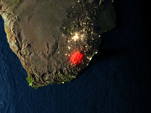 Lesotho in red from space at night Royalty Free Stock Photo