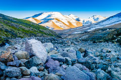 Lesotho Riverbed. A dry riverbed in the mountains of Lesotho, with snow on the hills in the background royalty free stock photography