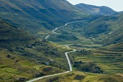 Lesotho Roads 10. Silver road snakes through the mountain pastures and cultivations Stock Image