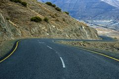Lesotho Roads 6. A winding tarmac road dives into the Orange River valley in Lesotho Stock Photo