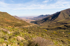 Lesotho Valley. A view looking down into the valley on the way up the Mafika Lisiu Pass in Leribe, Lesotho during the dry winter season royalty free stock images