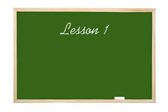 Lesson 1. Green chalk board with handwritten Lesson 1 - isolated on white Stock Photos