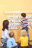Lesson. Teacher and two preschoolers during lesson Stock Photography