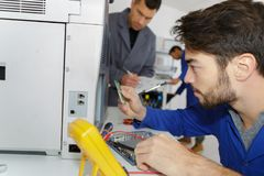 Lesson with electrician and apprentice Royalty Free Stock Photos