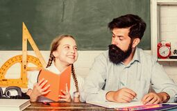 Lesson is finished. Discipline upbringing. Man bearded pedagogue study together with kid. Study is fun. School teacher