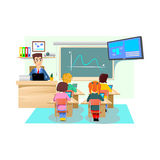Lesson In Classroom At School Or College, Teacher Explains Lesson Near Desk In Front Of Students, Children Sit On Chairs Royalty Free Stock Photos