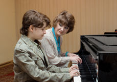 Lesson of music. At children's musical school Stock Photos