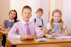 During lesson. Students sit at their desks during a lesson. Education Stock Images