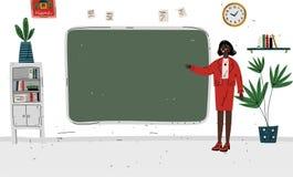 Free Lesson. Teacher Standing Near Blackboard In Classroom. Stock Images - 157003754