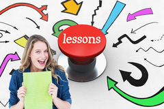 Lessons against digitally generated red push button. The word lessons and smiling student holding notebook against digitally generated red push button Stock Photos
