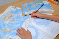 Lessons in geography. The child makes favorite lessons in geography royalty free stock images