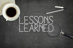 Lessons learned concept on black blackboard Stock Photography