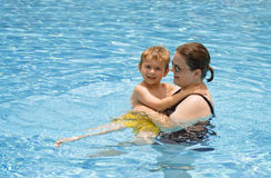 Lessons in the Pool. A little boy and his mom in the pool together Stock Images