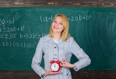 Lessons schedule. Welcome teacher school year. Experienced educator start lesson. What time is it. She cares about stock photos