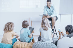 Lessons in an unusual classroom. Using a smartphone and tablet. Modern teaching concept royalty free stock image