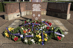 Lest We Forget, Anzac Day memorial. Flowers adorn an ANZAC day memorial for the remembrance of fallen Australian and New Zealand military personnel during WW1 Royalty Free Stock Images