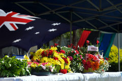 Lest we forget. Offerings of flowers with Australian flag in background as tribute to the fallen soldiers, Anzac Day, Australia; concept of tribute to loved ones Royalty Free Stock Photos