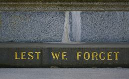 Lest We Forget text on stone royalty free stock images