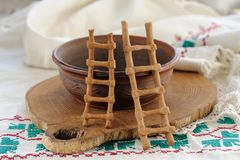 Lestvitsi, Russian rye festive spring cookies, clay bowl and rus Royalty Free Stock Photo