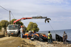 LESVOS, GREECE OCTOBER 07, 2015: Lifejackets, rubber rings an pieces of the rubber dinghys discarded on a beach near Molyvos. Eftalou and Skala Sikaminia stock image