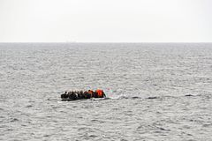 LESVOS, GREECE october 08, 2015: Refugees arriving in Greece in dingy boat from Turkey. Royalty Free Stock Photography