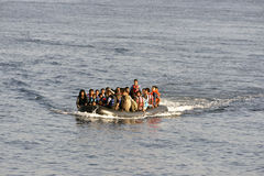 LESVOS, GREECE october 12, 2015: Refugees arriving in Greece in dingy boat from Turkey. Royalty Free Stock Photos