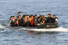LESVOS, GREECE october 12, 2015: Refugees arriving in Greece in dingy boat from Turkey. These Syrian, Afghanistan and African refugees land their boat at the royalty free stock images
