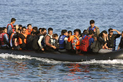 LESVOS, GREECE october 12, 2015: Refugees arriving in Greece in dingy boat from Turkey Stock Photography