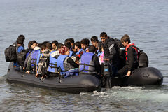 LESVOS, GREECE october 12, 2015: Refugees arriving in Greece in dingy boat from Turkey. These Syrian, Afghanistan and African refugees land their boat at the royalty free stock photo