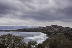 Lesvos- Molivos- Greek Island. Blue sea, light blue sky with white- black clouds, from greek island of lesvos Mytilini. A panoramic view of the small town of Royalty Free Stock Images
