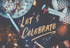 Let's celebrate hand brush stroke font on marble table with party cup,party blower,tinsel,confetti.Fun Celebrate holiday party royalty free stock image